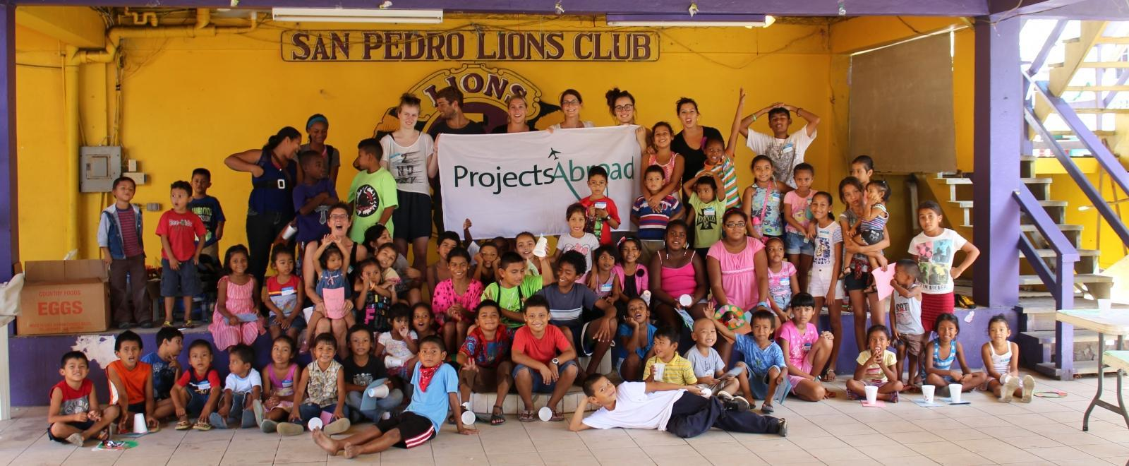 A group of volunteers takes part in conservation and community work in Belize for teenagers